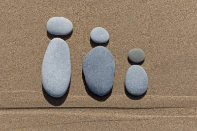 3 pebble people 1 large, 1 medium and 1 small