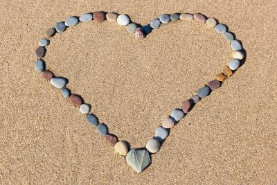 a heart made out of small pebbles on Pembrokeshire sand