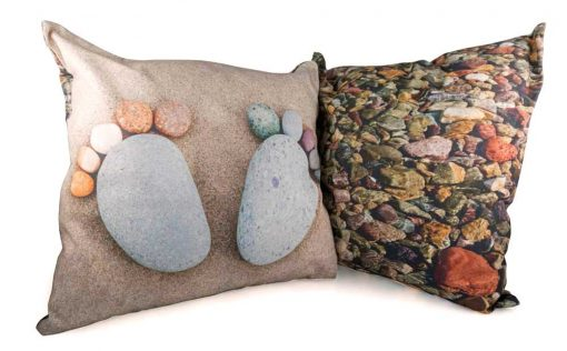two pebble feet and underwater pebbles on reverse of cushion