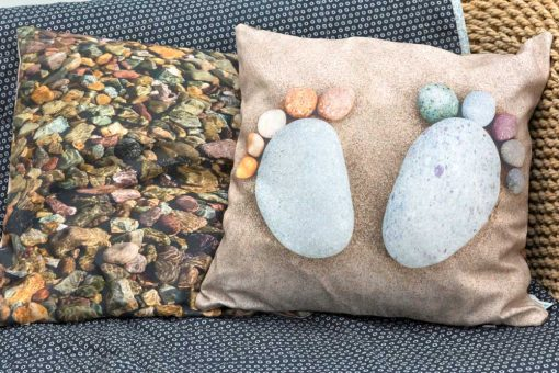 beautiful quality pebble art cushion with two feet and underwater pebbles on reverse