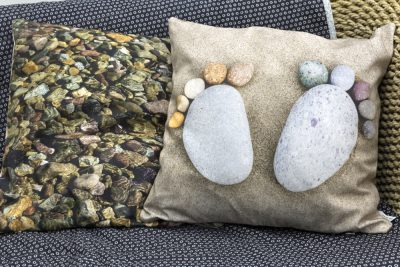 2 sided pebble cushion with pebble feet and underwater pebbles on reverse