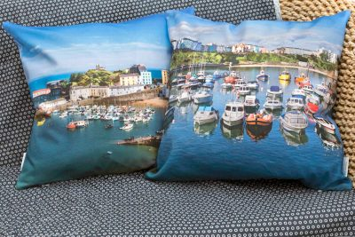 high quality panama cotton cushion with feather inner with high tide sunny image of tenby harbour on one side and then looking out at high tide from the harbour wall across bay with all the moored boats in the foreground of tenby harbour