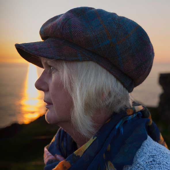 Rachel Mullett photographer looking out to sea at sunset