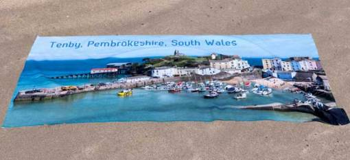 Beautiful beach towel with a stunning view of Tenby Harbour on the front