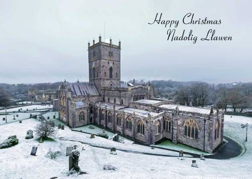Bi-lingual christmas card of St Davids Cathedral in the snow