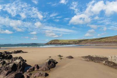 Looking across Manorbier Beach on a summer's day