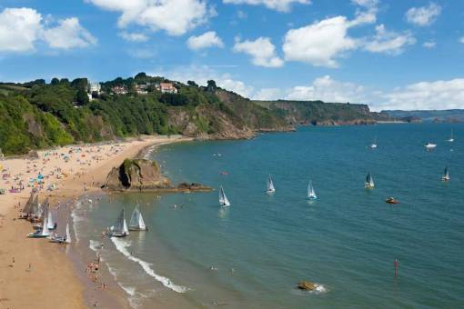 Tenby North beach on race day with sailing dinghies