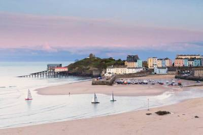 Pink skies after sunset on regatta day looking towards Tenby Harbour
