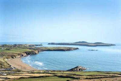 View from Carn llidi, down on to Whitesands beach and across to Ramsey Island on a summer's evening