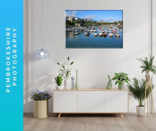 sitting room showing canvas of tenby harbour boats on wall