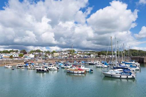 Sunny day at Saundersfoot Harbour looking across the marina to the town