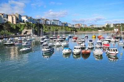 A shot taken down on the harbour wall at Tenby looking across to North beach Tenby with boats in Tenby Harbour