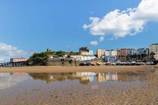 View back to Harbour from the beach with summer reflections in pools of the houses