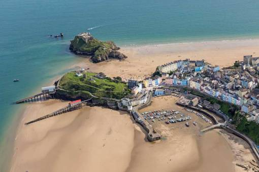 View from an aeroplane of Tenby Harbour at low tide shwoing St Catherines Island