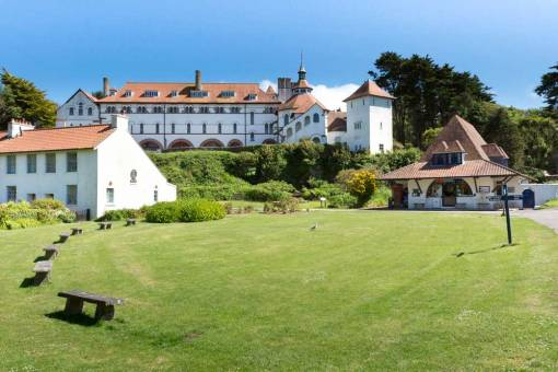 A view across the lawn to the buildings of Caldey up to the monastry