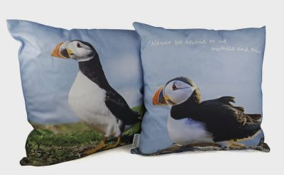 Standing puffin on one side and sitting puffin on reverse of cushion