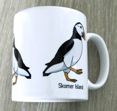 Mug with 3 graphic design puffins on and the words Skomer Island