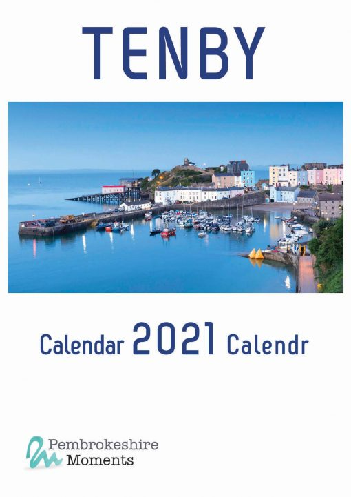 front of calendar with a stunning photo of Tenby Harbour at twilight