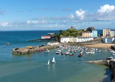 Looking down on Tenby Harbour with sailing boats in the foreground