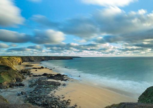 photo of Marloes beach taken on a slow shutter speed so it has milky seas and moody skies