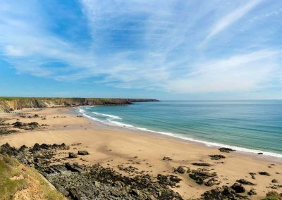 Bright summer's day in Pembrokeshire looking across Marloes beach from the Wales Coast Path