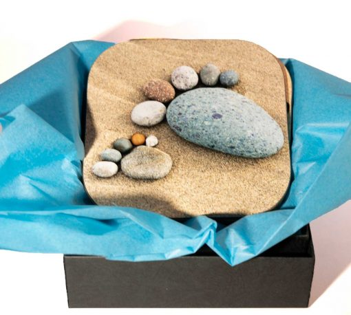 four beautiful high gloss coasters gift wrapped in tissue paper in a presentation box