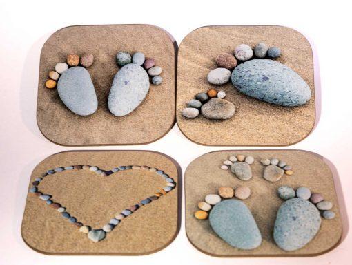 pebble heart and pebble feet on four high gloss coasters