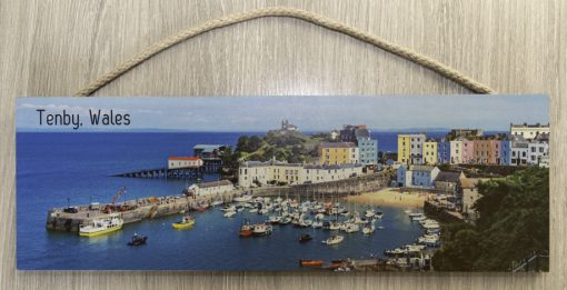Looking down on Tenby Harbour on a large hanging plaque