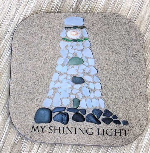 seaglass lighthouse built on sand with the words my shining light