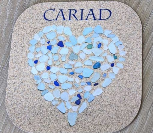 Seaglass heart with the words Cariad on a coaster