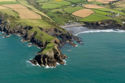 Abereiddy beach from the air with the blue lagoon peninsular in view