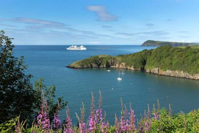 Cruise Wales bring cruise ships to Fishguard making these postcard views possible looking out over the lower town harbour entrance towards Dinas Head