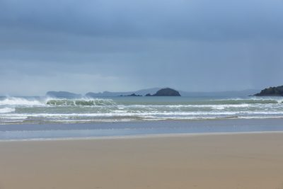 View at north end of Newgale towards Solva with storm clouds on the horizon a moody scene