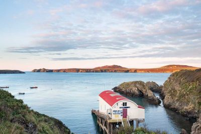 View over the old lifeboat station at St Justinians across to Ramsey Island early in the morning with the bracken on Ramsey Island looking golden brown