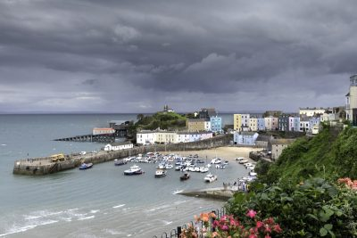 Stunning grey stormy skies over the pretty coloured houses of Tenby Harbour