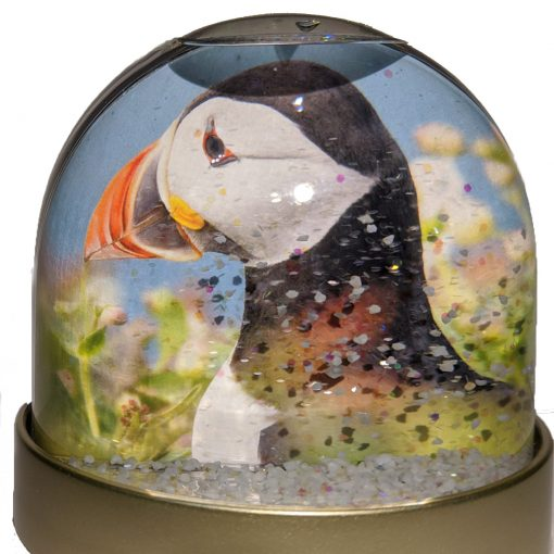 A double sided snowglobe with different images of Skomer Island Puffins on either side