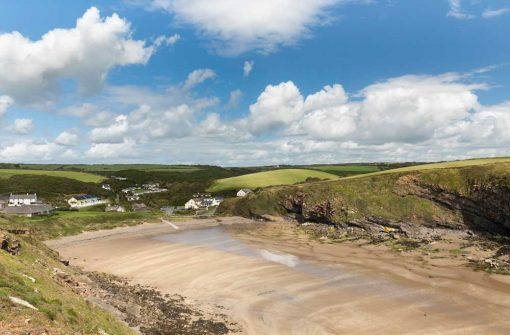 photo taken of nolton haven at low tide from the north cliff with a blue sky with fluffy white clouds - nolton at its finest