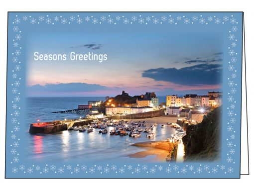 three beautiful sunrise images of Tenby made into christmas cards with snowflakes border