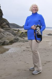 Pembrokeshire Photographer Rachel Mullett of Pembrokeshire Moments with camera on Newgale beach