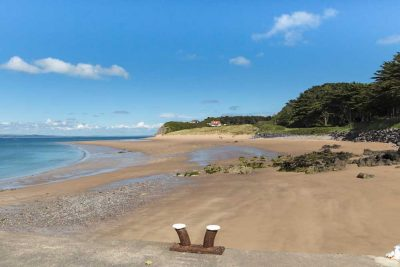 view from the slipway at caldey across the beautiful sandy beach on a sunny day