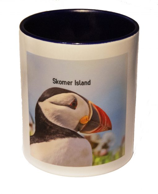 pen caddy with a dark blue inner and images of puffins front and back