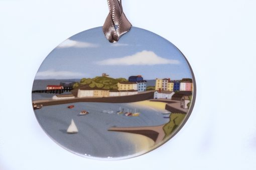 high gloss ceramic charm with a graphic design image of tenby harbour