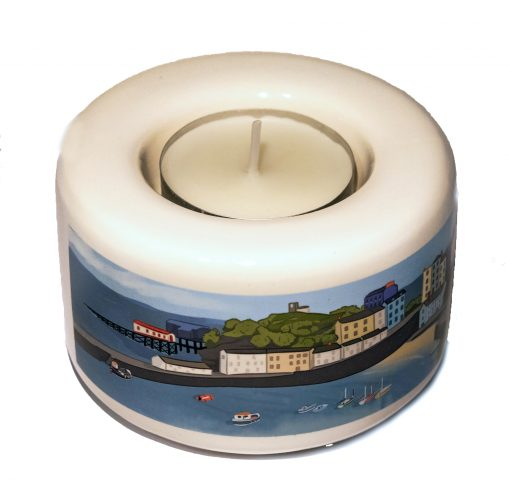 small ceramic tea light holder with a graphic art image of Tenby wrapping around the front with a red heart and tenby on reverse
