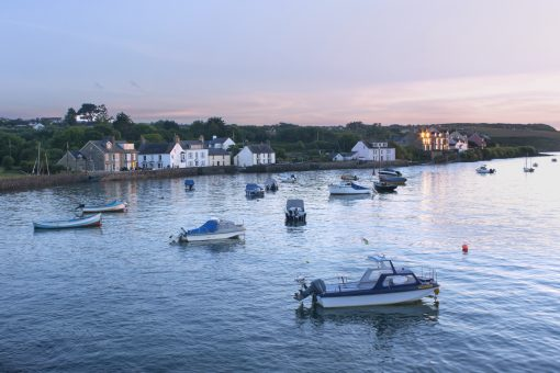 view from the Newport boat club at sunset on a summers evening at high tide