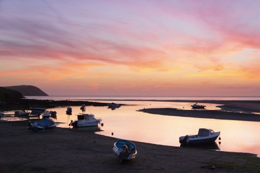 beautiful orange and pink colours over the estuary leading out from Newport with the boats on the sands
