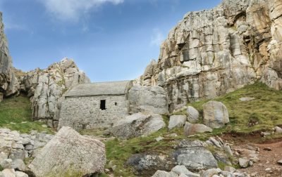 looking up at the tiny st govans chapel tucked in to the cliffs in south pembrokeshire