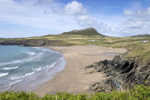 a view from the pembrokeshire coastal path looking across whitesands to carn llidi