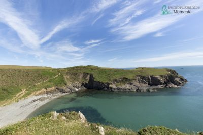 looking south from the gribin, solva down on to gwdan beach with crystal clear waters